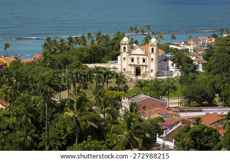 Aerial view of Olinda in Pernambuco, Brazil on a sunny summer day  showcasing some of its historic architecture with the Atlantic Ocean on the background. - stock photo