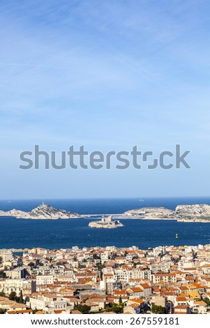 aerial view of one of the Frioul islands and the town of Marseilles, France - stock photo