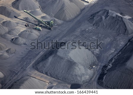 Aerial view of ore  storage in Rotterdam harbor, The Netherlands. - stock photo