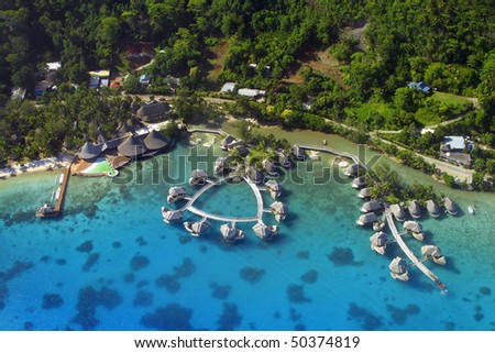 Aerial View of over water bungalows at Bora Bora. - stock photo