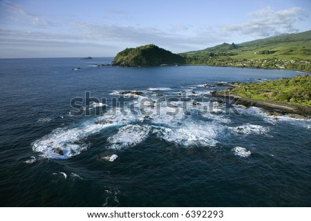 Aerial view of Pacific ocean on rocky Maui, Hawaii coast.
