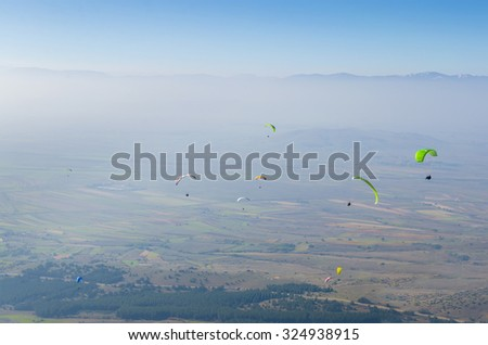 Aerial view of paragliders at sport paragliding contest - stock photo