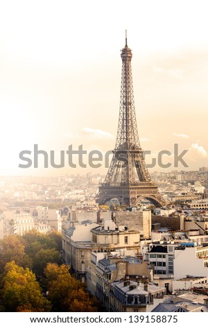 Aerial view of Paris and Eiffel Tower at sunset with copy space. - stock photo
