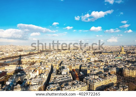 Aerial view of Paris, including views of Notre Dame Cathedral, Basilica Sacre Coeur, River Seine, and shadow of the Eiffel Tower - stock photo