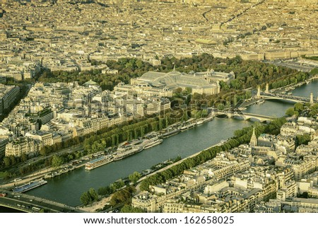 Aerial view of Paris with Seine River and Grand Palace with french flag, France - stock photo