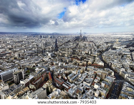 aerial view of paris with the eiffel tower at the horizon - stock photo