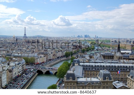 Aerial view of Paris with the Eiffel tower, Louvre, river Seine and La Defense in the distance - stock photo