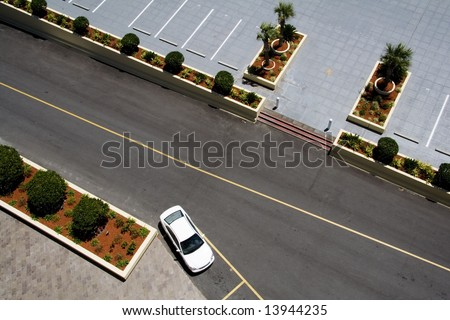 Aerial View of Parking Lot with Car in Space - stock photo