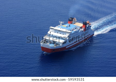 Aerial view of passenger ferry boat in open waters in Greece - stock photo