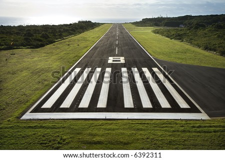 Aerial view of paved airplane runway on Maui, Hawaii. - stock photo