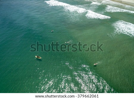 Aerial view of People Surfing, Juquehy, Brazil - stock photo