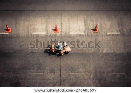 Aerial view of peoples ride motorcycle on the road, movement shot - stock photo