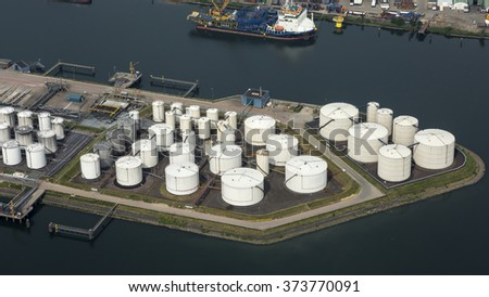 Aerial view of petrol industrial zone and a harbour. It's the Vopak Terminal in Dordrecht, Netherlands. - stock photo
