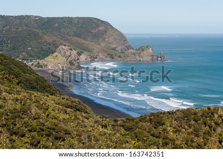 aerial view of Piha beach and Waitakere Ranges - stock photo