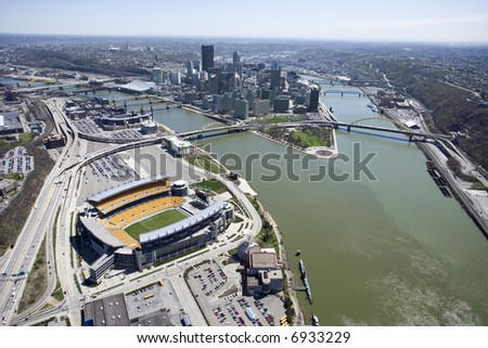 Aerial view of Pittsburgh, Pennsylvania with skyscrapers and stadium and rivers. - stock photo