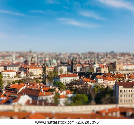 Aerial view of Prague from Prague Castle with tilt shift toy effect shallow depth of field. Prague, Czech Republic - stock photo