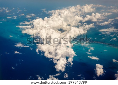 Aerial view of pretty clouds and Florida keys - stock photo