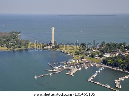 aerial view of Put in Bay's marina and Perry's Victory & International Peace Memorial, Kelley's Island in the far background; Put-in-Bay, South Bass island Ohio USA - stock photo