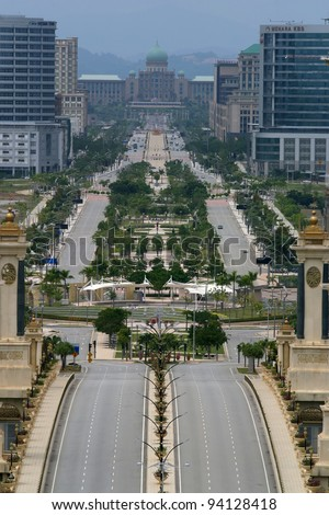 Aerial view of Putrajaya's famous landmark, the Prime Misister office at the end of the road. - stock photo