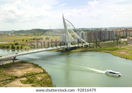 Aerial view of Putrajaya's famous landmark, the Wawasan Bridge - stock photo