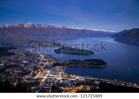 Aerial view of Queenstown downtown at dusk, South Island, New Zealand - stock photo