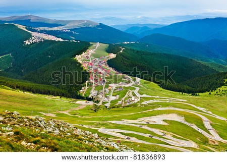 Aerial view of Ranca town and resort in Parang mountains, Romania - stock photo