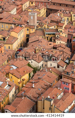 Aerial view of red tiled rooftops and ancient towers in historical center of Bologna, Italy - stock photo