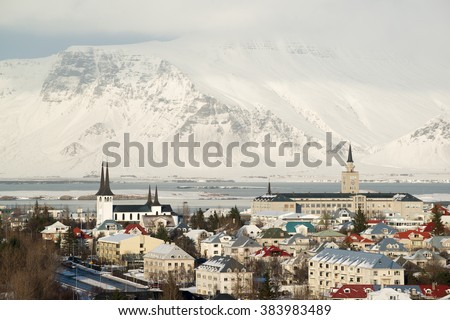 Aerial view of Reykjavik from Perlan, snow capped mountains in winter, Iceland - stock photo