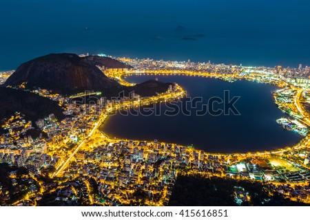Aerial view of Rio de Janeiro, by night. Copacabana, Ipanema, Leblon and Lagoa neighborhoods border Rodrigo de Freitas lagoon - stock photo