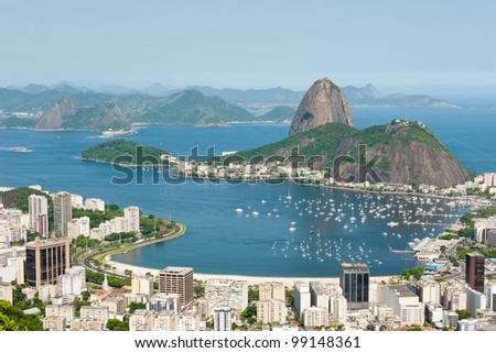Aerial View of Rio De Janeiro looking towards Sugarloaf Mountain and the Atlantic - stock photo