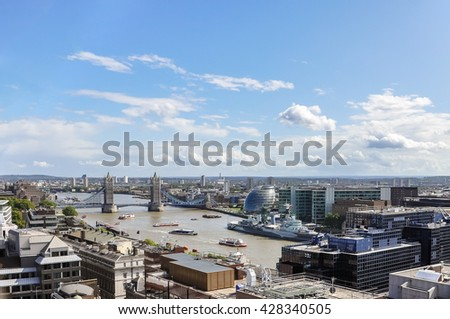 Aerial view of River Thames in London including Tower Bridge, City Hall and HMS Belfast - stock photo