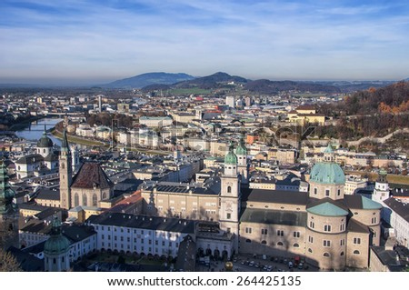 Aerial view of Salzburg, Austria with Franciscan Church, river and mountains at the background