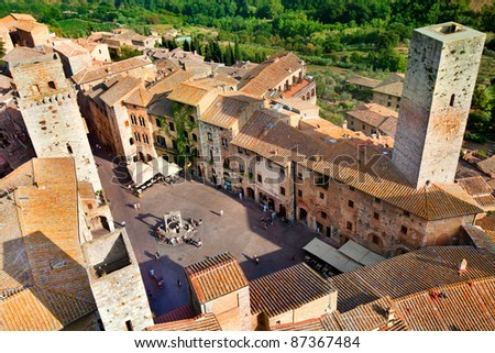 Aerial view of San Gimignano from the tower of the Palazzo del Popolo, Tuscany, Italy - stock photo