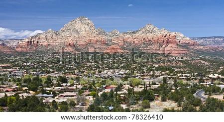 Aerial view of Sedona, Arizona with red rocks surrounding the valley - stock photo