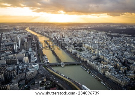 Aerial view of Seine River, high above Paris during sunset, from top of Eiffel Tower  - stock photo