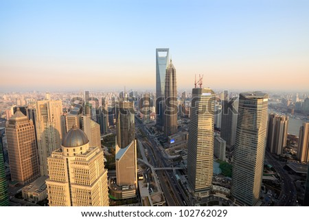 aerial view of shanghai lujiazui finance and trade zone at dusk from the oriental pearl tower - stock photo