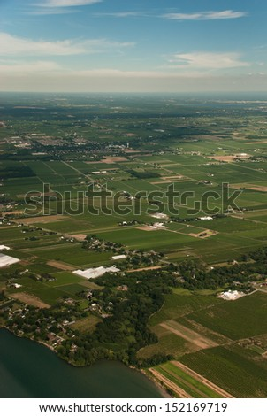 Aerial view of shoreline and agriculture - stock photo