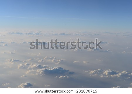 aerial view of sky and clouds from jet flight - stock photo