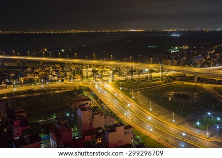 Aerial view of skyline city at twilight. Hanoi cityscape at Nhat Tan bridge