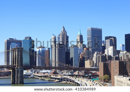 Aerial view of Skyscrapers in Financial District of Lower Manhattan through Brooklyn Bridge, New York City, USA. - stock photo