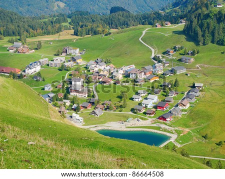 Aerial view of small swiss village in alps