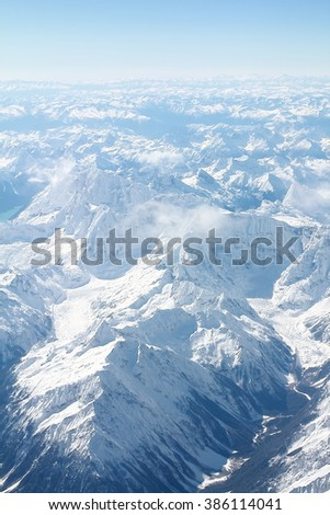 Aerial view of snow covered mountain peak.