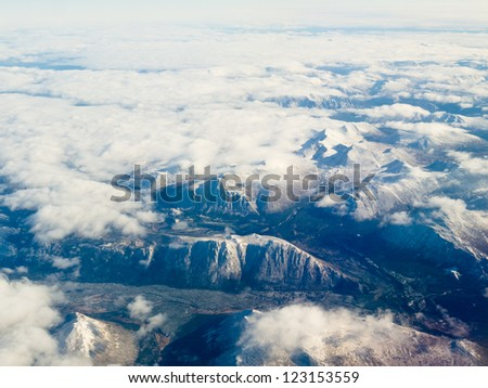 Aerial view of snowcapped mountains in northern part of the province of beautiful British Columbia, Canada.