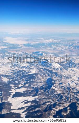 Aerial View of Snowy  Mountain. Photo taken from airplane near Phoenix, Arizona. - stock photo