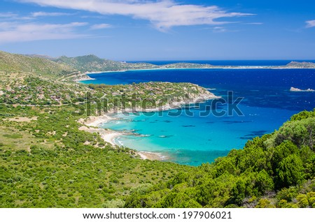 Aerial view of South Mediterranean coast of Sardinia Island, Italy. Famous sunny beaches of white sand. Blue Mediterranean sea. Beautiful touristic landscape in the spring.