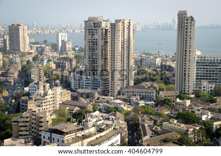 Aerial view of south Mumbai's skyline where old, heritage structures stand cheek by jowl with ultra modern skyscrapers and towers. View covers till luxurious Marine Drive, Nariman Pt and Cuffe Parade - stock photo
