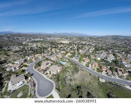 Aerial View of Southern California Neighborhood and Mt. Baldy - stock photo