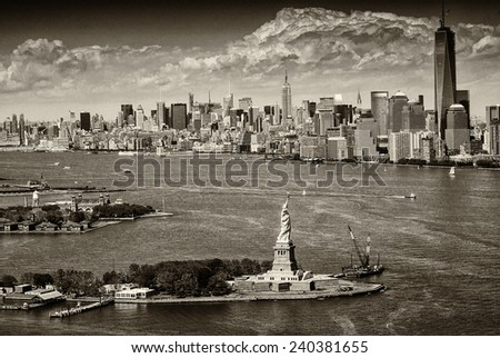 Aerial view of Statue of Liberty and Manhattan, New York City. - stock photo