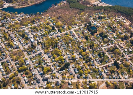 Aerial view of suburban Clinton, Massachusetts and water - stock photo