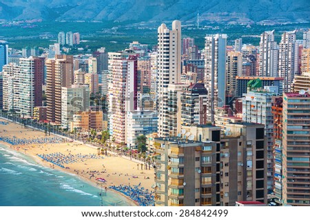 Aerial view of summer resort Benidorm, Spain with beach and famous skyscrapers. City has three major beaches of the maximum quality standard - stock photo
